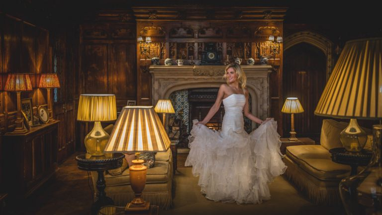 Off camera flash indoors photograph of a bride looking towards the flash. Wedding photography training courses