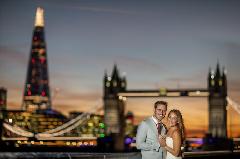 Bride and groom with Tower Bridge in London England.
