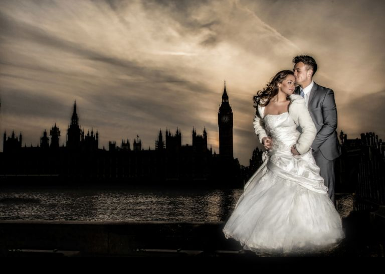 Bride and groom in front of the Houses of Parliament in central Lodnon